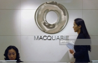 Macquarie buys $800 mn stake in LG Group's IT firm