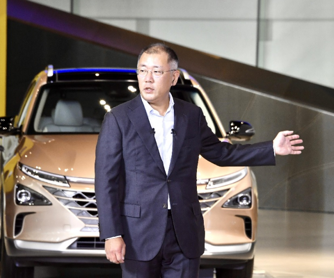 Chung Euisun takes helm at South Korea's largest automotive group Hyundai Motor. Here he unveils the company's Green New Deal at the Korean New Deal Initiative launch presided over by President Moon Jae-in on July 14